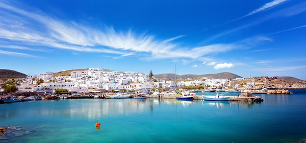 Panoramic view of idyllic old port with moored traditional boats, Paros